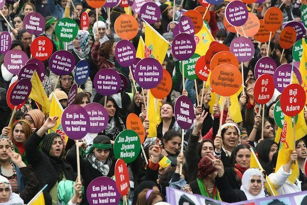 Turkish Kurd women hold placards reading