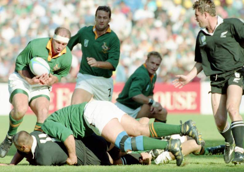 New Zealand player Jonah Lomu, bottom left, is tackled by South African players during the Rugby Union World Cup Final between South Africa and New Zealand at Ellis Park, Johannesburg, on June 24, 1995. South Africa defeated New Zealand 15 - 12, after extra time had been played. (AP Photo)