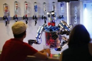 "Humanoid robot bartender ""Carl"" interacts with guests at the Robots Bar and Lounge in the eastern German town of Ilmenau, July 26, 2013. ""Carl"", developed and built by mechatronics engineer Ben Schaefer who runs a company for humanoid robots, prepares spirits for the mixing of cocktails and is able to interact with customers in small conversations. Picture taken July 26, 2013. REUTERS/Fabrizio Bensch (GERMANY - Tags: SOCIETY SCIENCE TECHNOLOGY BUSINESS TPX IMAGES OF THE DAY)"