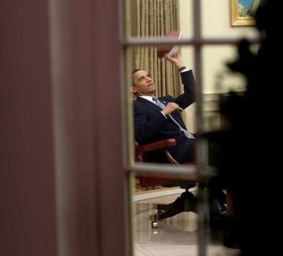 april-23-2009-president-barack-obama-plays-with-a-football-in-the-oval-office