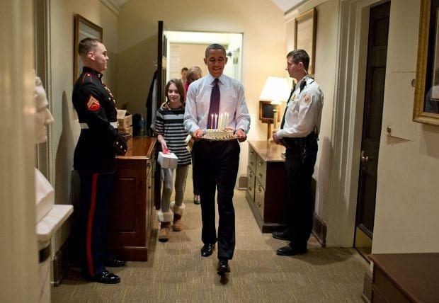 dec-2-2013-joined-by-chief-of-staff-denis-mcdonoughs-daughter-the-president-carries-a-birthday-cake-to-surprise-mcdonough-in-his-west-wing-office-620x428