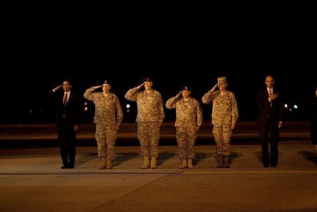 oct-29-2009-president-barack-obama-attends-a-ceremony-at-dover-air-force-base-in-dover-del-for-the-dignified-transfer-of-18-us-personnel-who-died-in-afghanistan-620x414